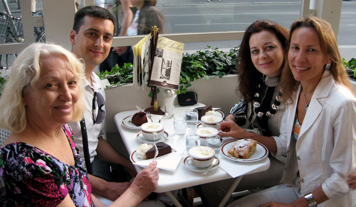 Vienna coffee house. Guests of Friends in Vienna enjoy famous Austrian dessert with melange coffee